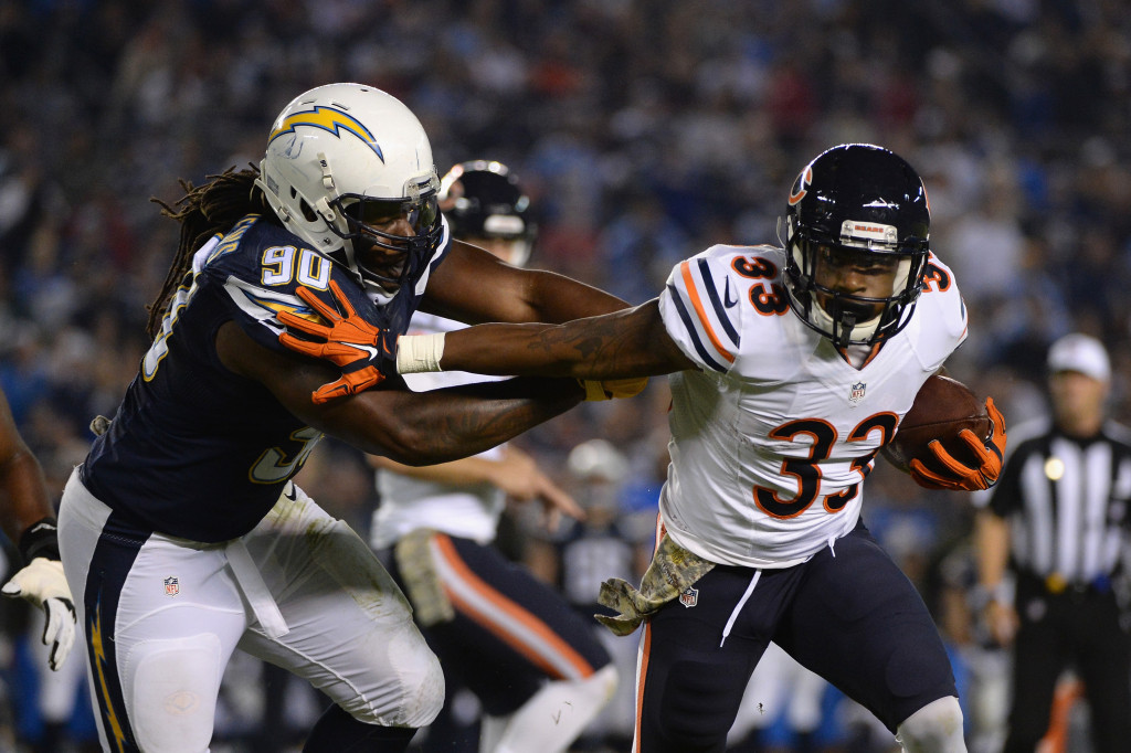 SAN DIEGO, CA - NOVEMBER 09: Jeremy Langford #33 of the Chicago Bears is pursued by Ricardo Mathews #90 of the San Diego Chargers at Qualcomm Stadium on November 9, 2015 in San Diego, California. (Photo by Donald Miralle/Getty Images)