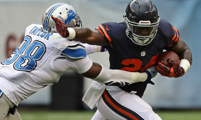 CHICAGO, IL - OCTOBER 02: Jordan Howard #24 of the Chicago Bears tries to break away from Devin Taylor #98 of the Detroit Lions at Soldier Field on October 2, 2016 in Chicago, Illinois. (Photo by Jonathan Daniel/Getty Images)